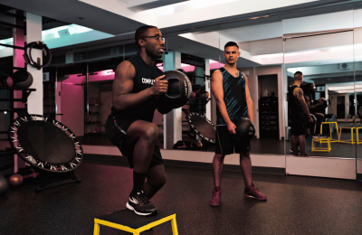 instructor and members during HIIT workout at CompleteBody Financial District