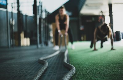 trainer using battle ropes