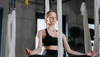 Completebody instructor at a barre class